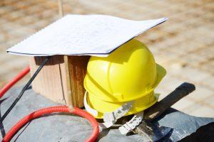 hardhat and renovation blueprints