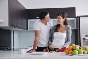 couple cooking in modern kitchen